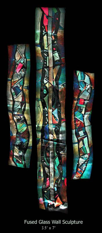 Fused glass wall sculpture, contemporary design.  Rippled ribbons of color.